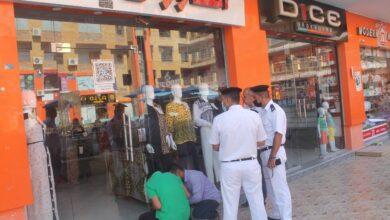 صورة رئيس الجهاز: غلق وتشميع محال تجارية مخالفة فى مدينة السادات